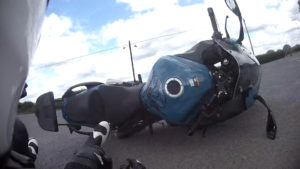 Biker and bike fall to the ground